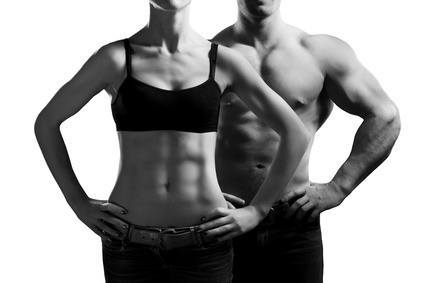 Bodybuilding. Strong man and a woman posing.